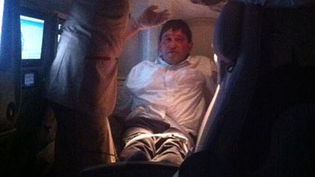 A passenger on board a Brisbane - bound Emirates flight was tied up after he tried to smoke several times during the flight.
