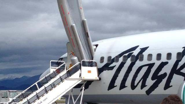Accidental slide deployment delays Alaska Airlines flight